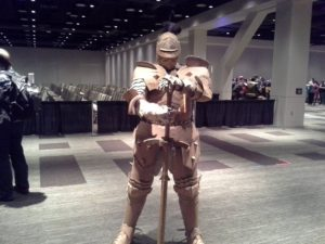 All cardboard, though only the front of the armor. Yes, there is a man in there. Yes, he did walk around.